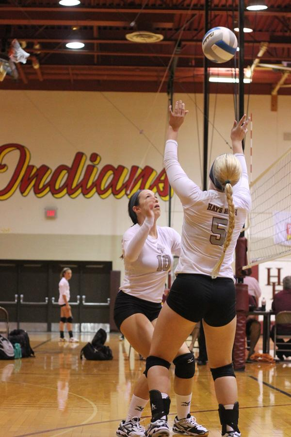 Junior Madison Prough sets the ball for senior Ashlyn Parrish at the Hays Tri on Sept. 5. On Sept. 9, the team traveled to Goodland and posted three victories.