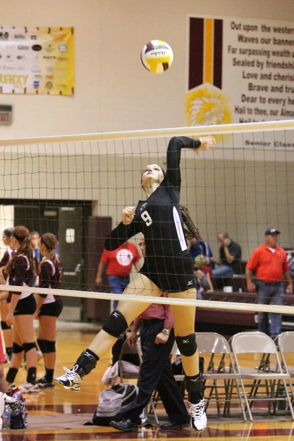 Junior Kylie Brown goes for a spike during the warm up at the Hays meet. The team went 1-2 at the Garden City Quad.