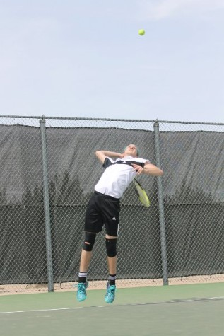 Boys tennis plays at home