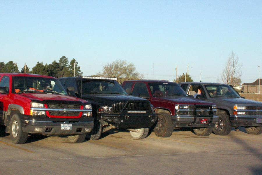 Students line-up their pickups each morning before school at the back of the parking lot, commonly referred to as Hick Row. Those who proudly park there share a variety of common interests.