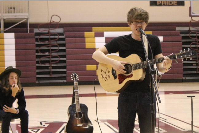 Former+student+performs+songs+for+student+body