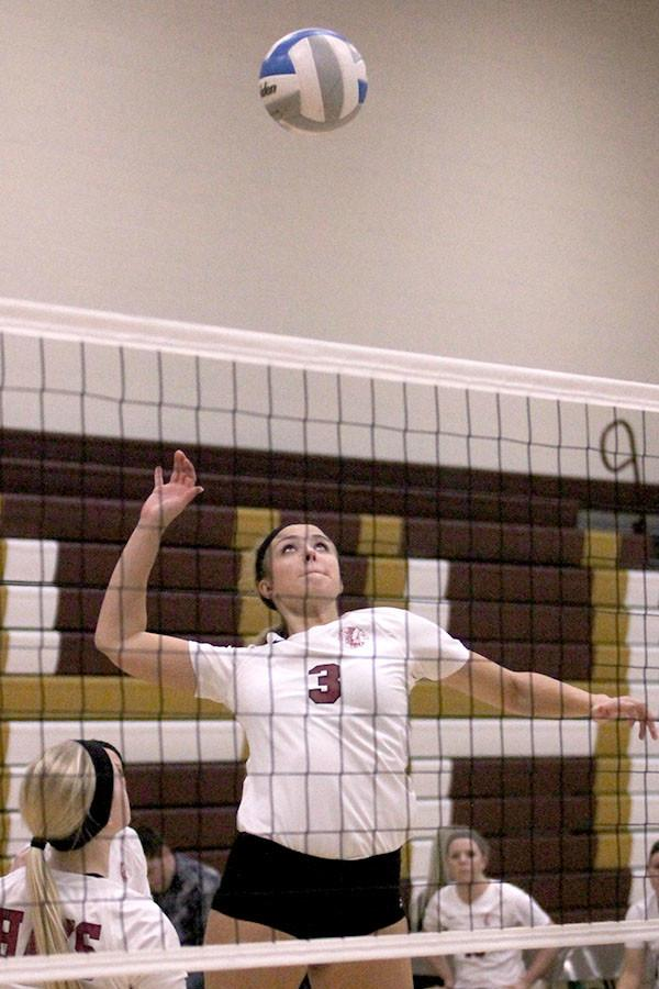 Senior Morgan Klaus goes up for a spike attempt in recent volleyball action on Oct. 5 at the Hays High gym. The team is now 22-3 on their season.