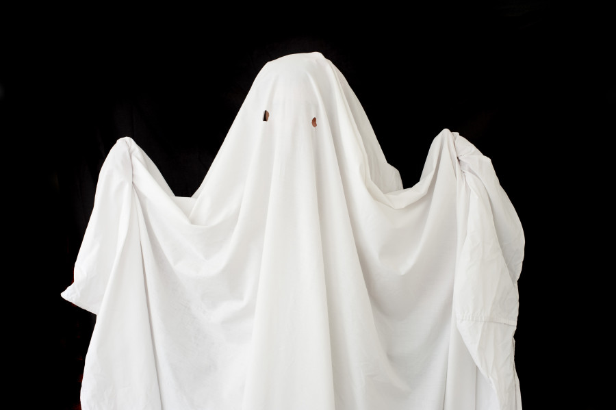 a figure wearing a halloween ghost costume