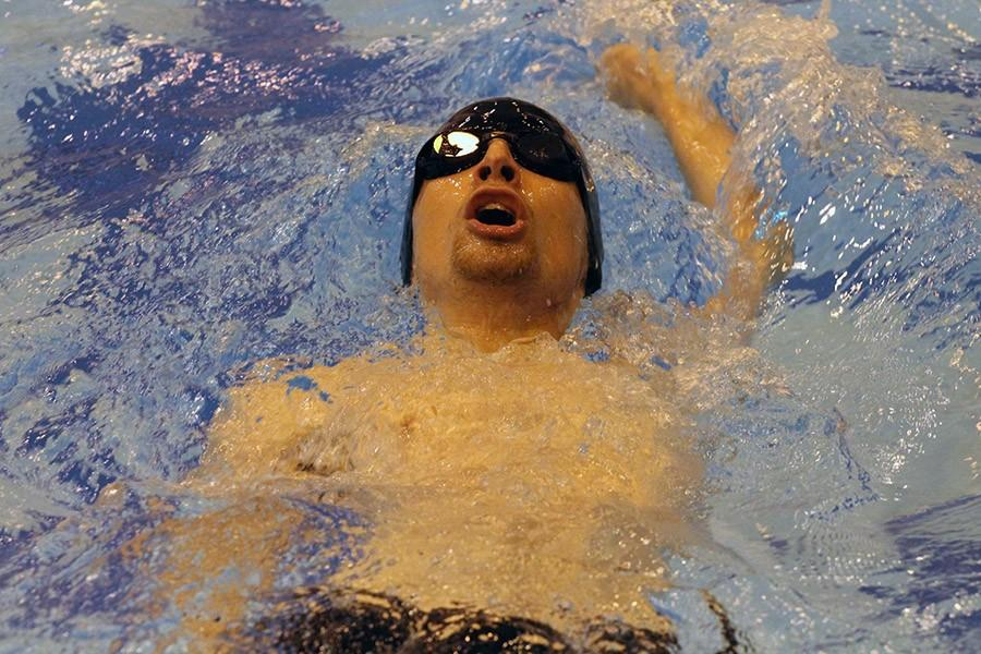 Senior Scott Ring swims the backstroke at Salina South on Jan. 7.