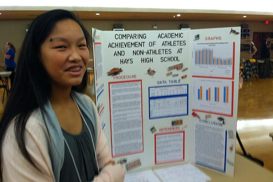 Freshman Cori Isbell presents her science fair project which compared the academic achievements of athletes to those of non-athletes.