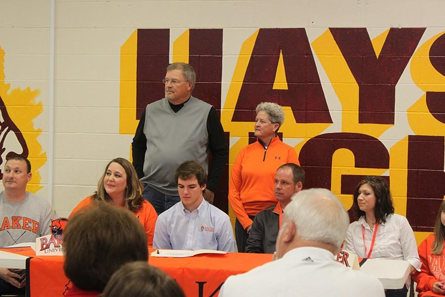 Ruder+gets+ready+to+sign+to+play+golf+for+Baker.+