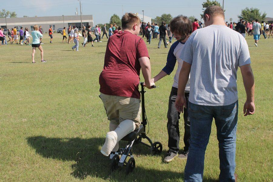 Seniors Mikhal Brown, Brayden Dreher and Aiden Lawson make their way to the senior line for the evacuation drill.