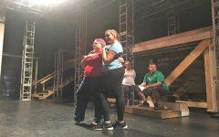 Senior Rachelle Lumpkins (Mrs. Doris MacAffe), and senior Kristen Nease (Kim MacAffe), rehearse a scene together.