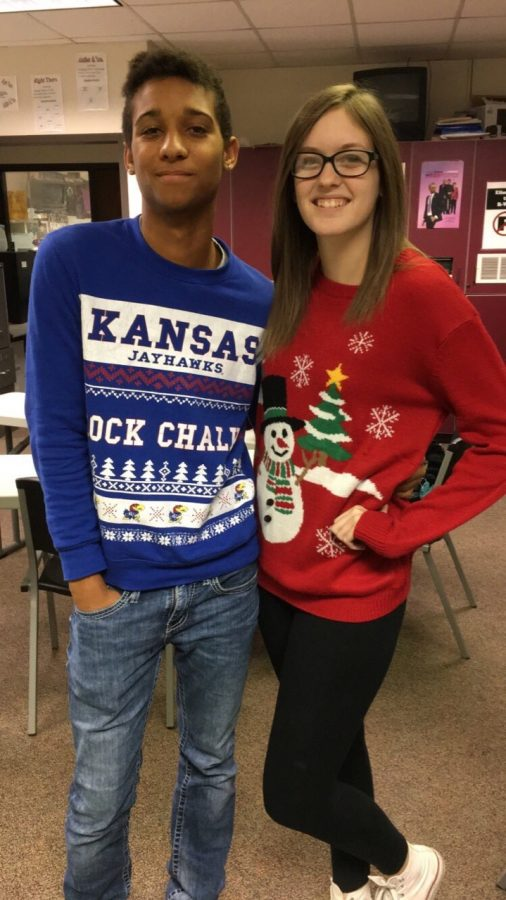 Seniors MKilar Otte and Cassandra Quinby wear their holiday sweaters.
