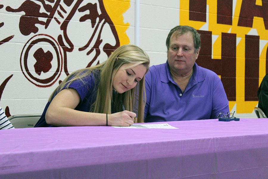 Senior Rachel Taylor signed to Dodge City Community College for volleyball on Nov. 30 in the cafeteria.
