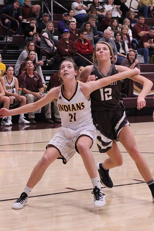 During+the+Lady+Indian+basketball+game+against+Garden+City+on+Dec.+1%2C+sophomore+Savannah+Schneider+blocks+out+for+a+rebound.+