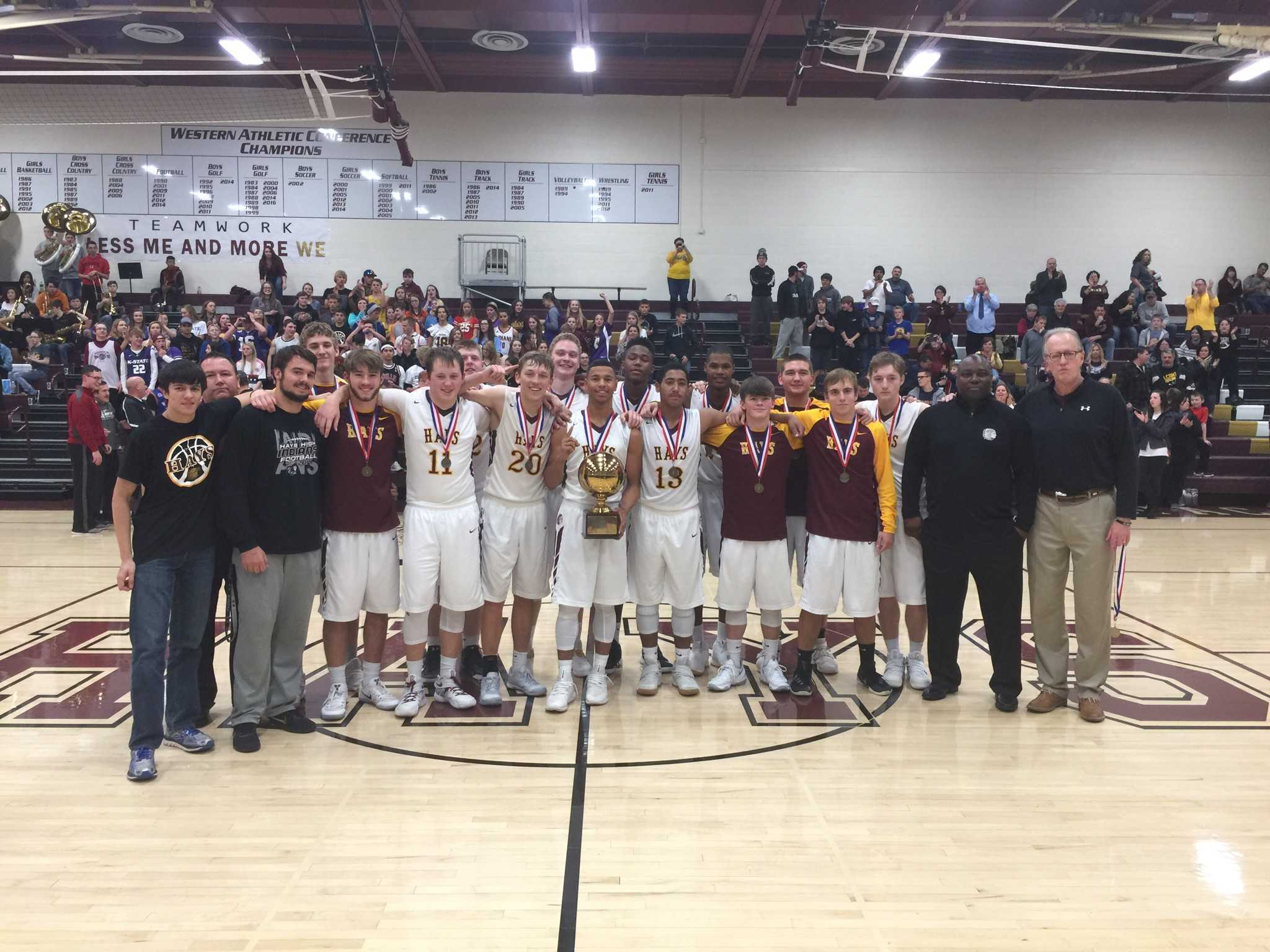 Hays High mens basketball team accepts first place trophy from the Hays City Shootout.