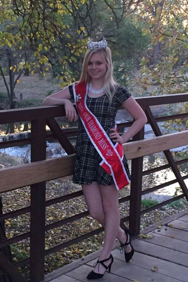Sophomore Alycia McVay stands showing her Diamond Miss sash off.