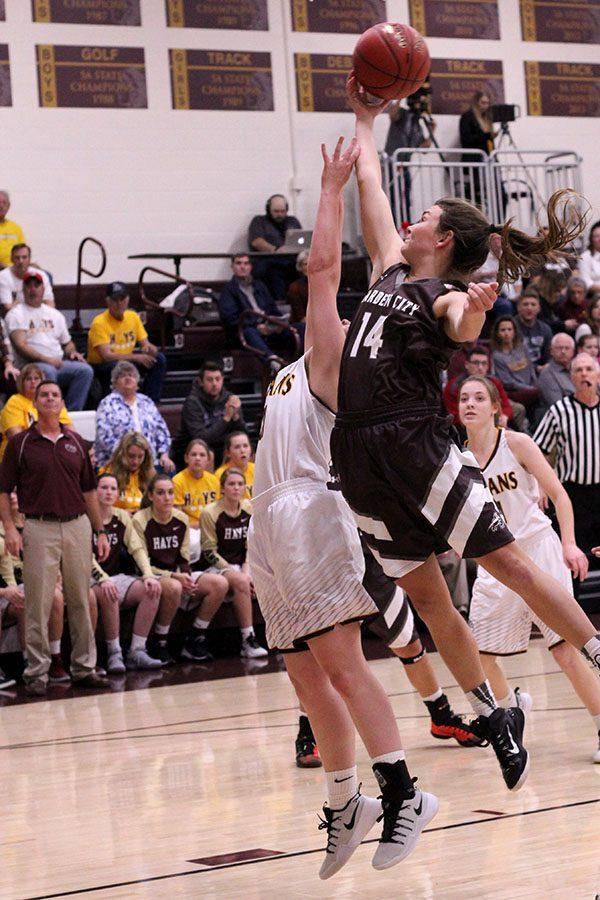 Sophomore Mattie Hutchison jumps for a rebound in a recent game against the Garden City Buffalos. The Lady Indians placed fifth in the McPherson Tournament over the weekend of Jan. 27-29.