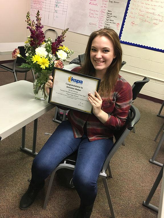 Senior Anniston Weber smiles after just finding out she won the KSPA Student Journalist of the Year award for 3A/4A.