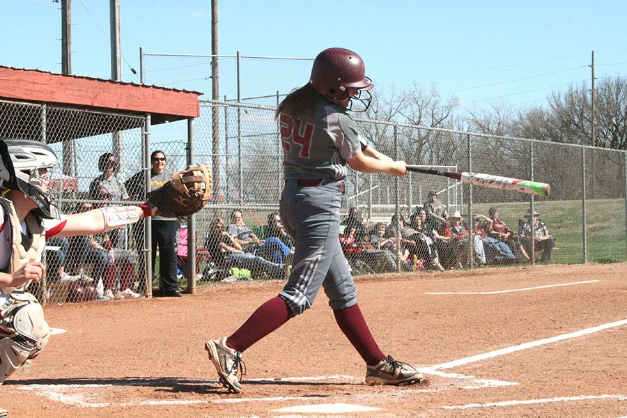 Senior Cameron Jensen swings through at a home game against the Red Demons on April 6.