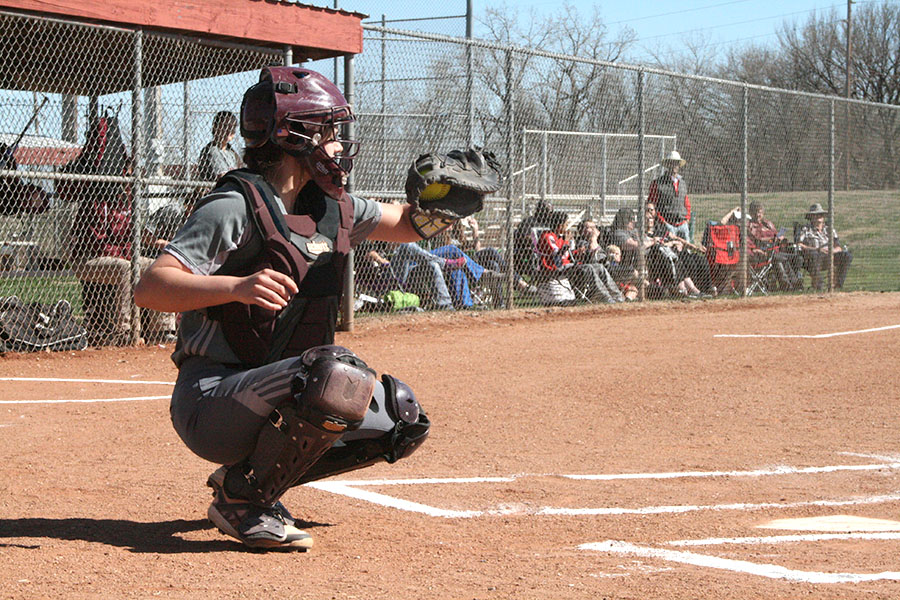 Sophomore catcher MacKenzie Fagan catches a ball from the picther and hopes for a strike in a recent game against the Dodge City Red Demons. On April 20, the Indians fell to the Great Bend Panthers at home.