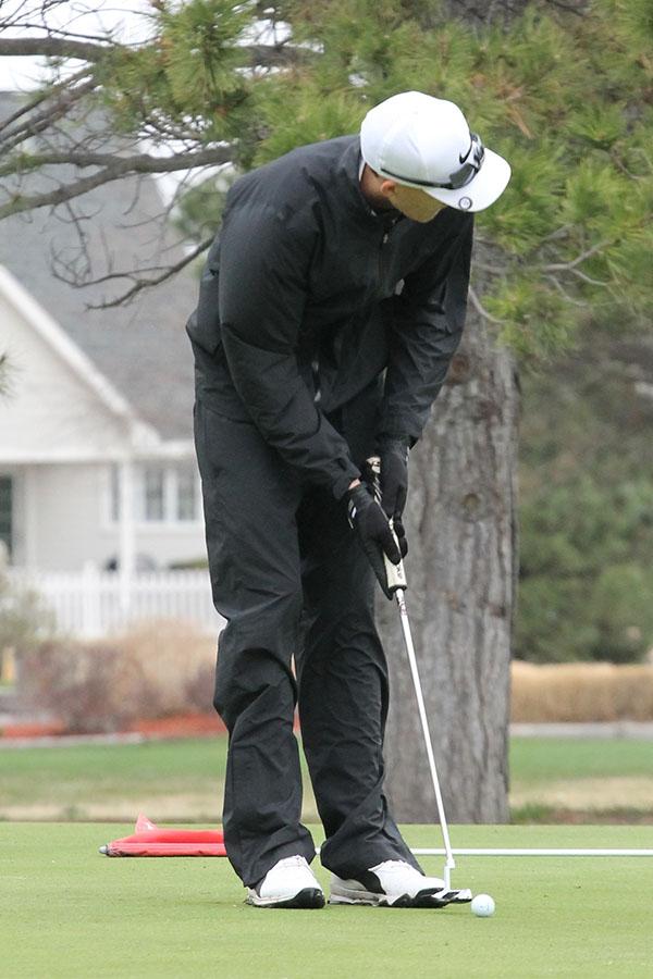 Senior Brent Koengsman lines up a shot at the Hays Invitational.