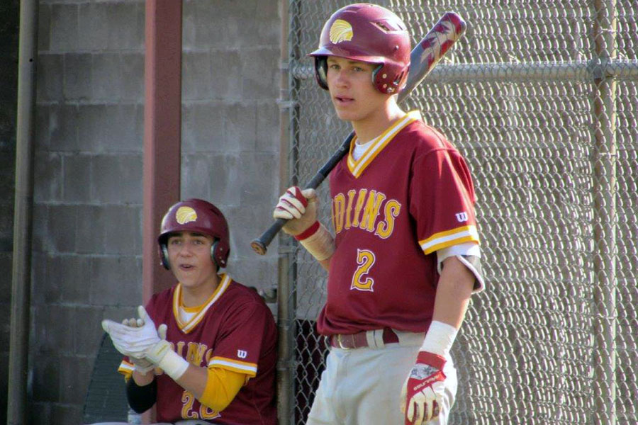 Junior Dawson Harman waits for his turn to bat while senior Jace Armstrong cheers on his batting teammate during the 2017 season. Harman is now a senior while Armstrong graduated.