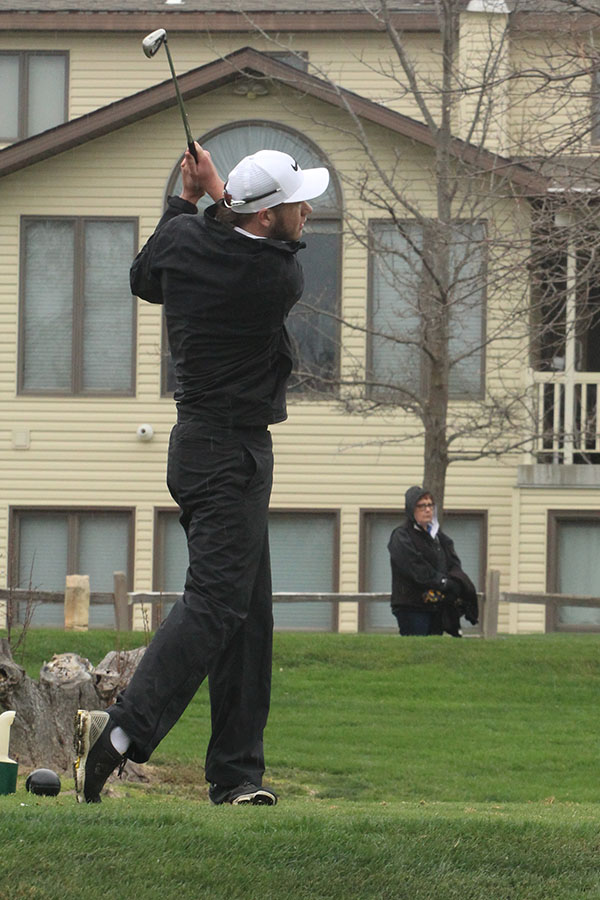 Justin McCullick taking a swing at the Hays Invitational