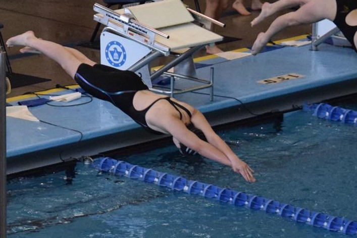Sophomore+Megan+Flavin+dives+into+the+water+for+her+500+freestyle+at+State.+This+was+Flavin%27s+first+year+at+State.