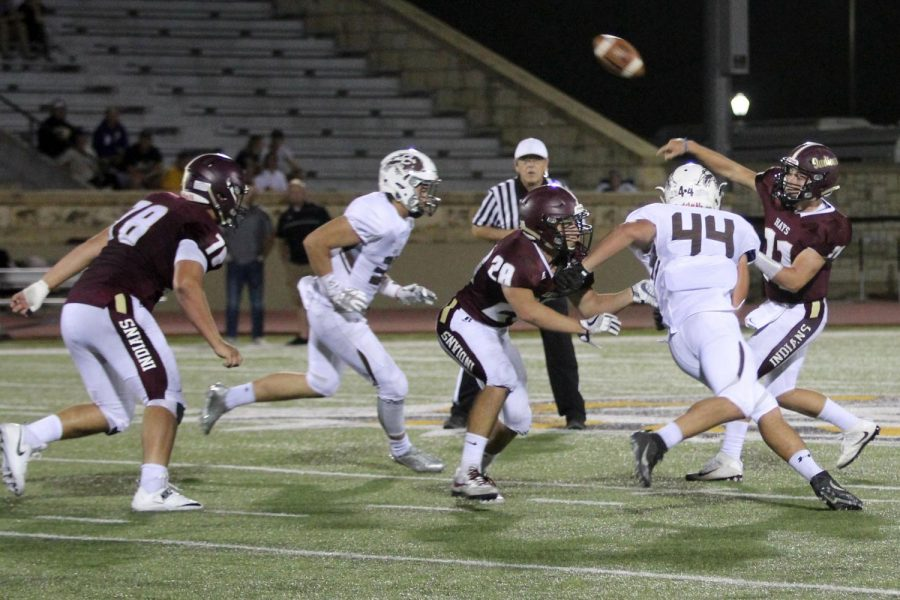 Senior Hunter Browns throws a pass and hopes to hit someone for a touchdown in a recent game against the Garden City Buffalos. The Indians lost to the Dodge City Red Demons on Oct 6.