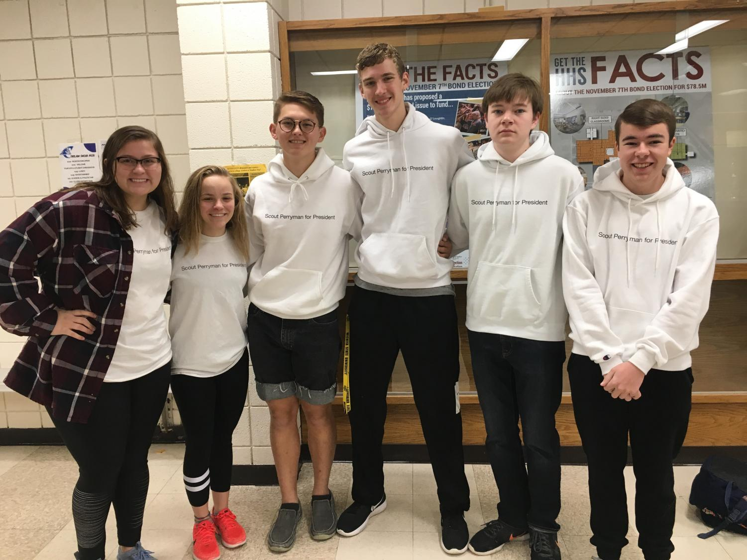 Juniors Shyann Schumacher, Isabelle Braun, Scout Perryman, Cade Swayne, Spencer Wittkorn and Cameron Karlin smile in their printed shirts and hoodies.
