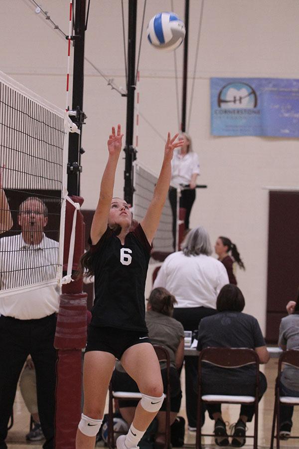 Junior Hannah McGuire sets the ball at home vs Garden City