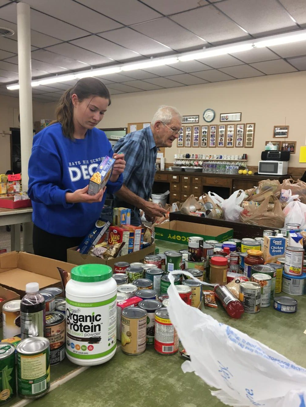 Senior Lisa Schoenberger marks the labels on the cans so they cannot be returned. Every can was counted and then sent to have that done.