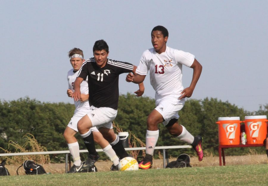 Junior+Trey+McCrae+dribbles+up+field+at+the+Great+Bend+defense+in+a+recent+home+match+up.+
