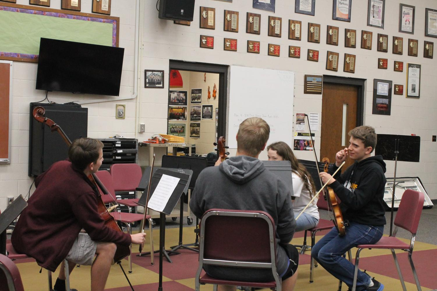 The quartet begins practice for their upcoming concert.