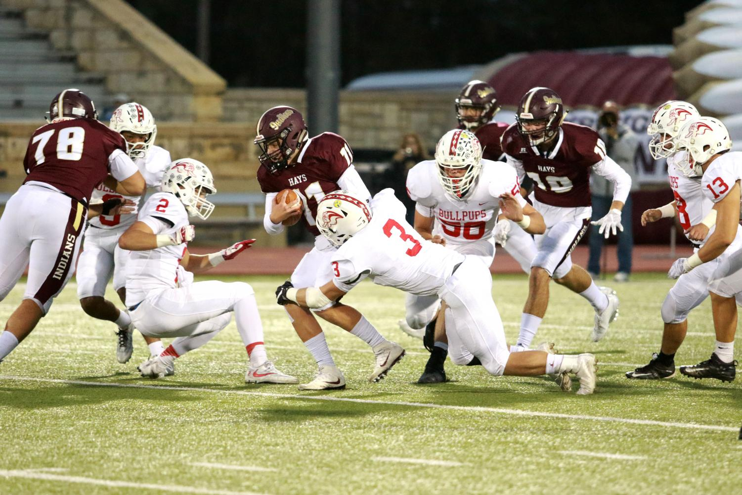 Senior Hunter Brown tries to weed through McPherson defenders in a recent game against the McPherson Bullpups. The Indians lost to the Wamego Red Raiders 24-21 on Oct. 27 to end their season.