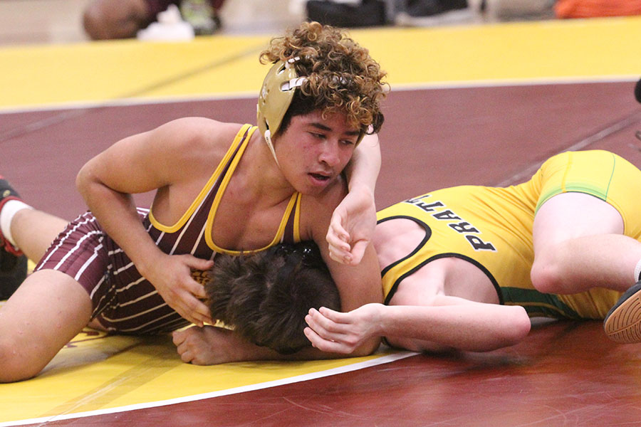 Freshman Cesar Macias competing at home against Pratt. The wrestling team will compete on Dec. 15 at Lincoln.