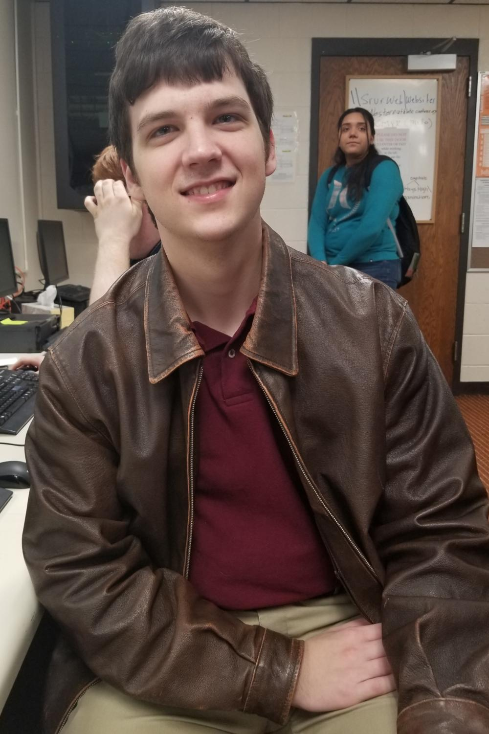 Senior Tanner Eiland poses for a photo in the WebTeam class. He joined WebTeam this year.
