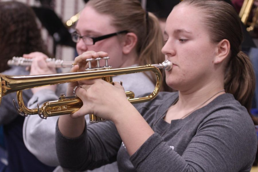 Sophomore+Chloe%0AFitzhugh+plays+her+trumpet+during+a+break+in+the+Basketball+game.+%0A