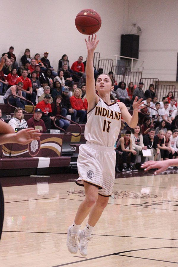 Junior Kallie goes in for a layup against the Great Bend Panthers.