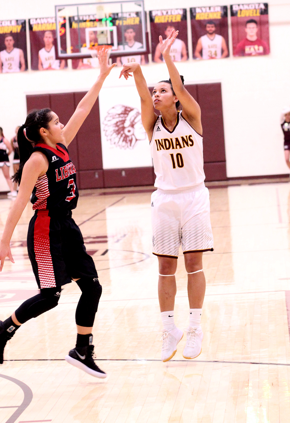 Sophomore Tasiah Nunnery pulls up for a shot in a recent game against the Liberal Redskins.