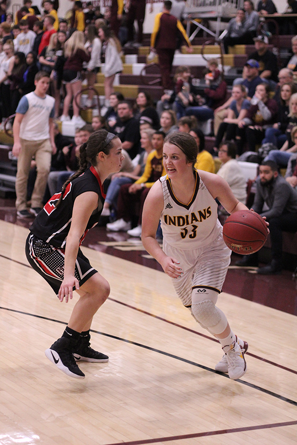 Sophomore Brooke Denning drives into the lane for a shot in a recent game against the Great Bend Panthers. On Feb 13, the Indians pulled off a win over the Abilene Cowgirls, 57-37.