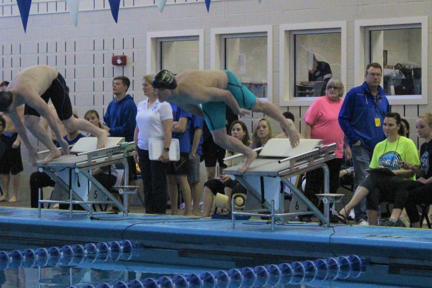 Sophomore Isaac Smith dives in for his 100 Butterfly final
