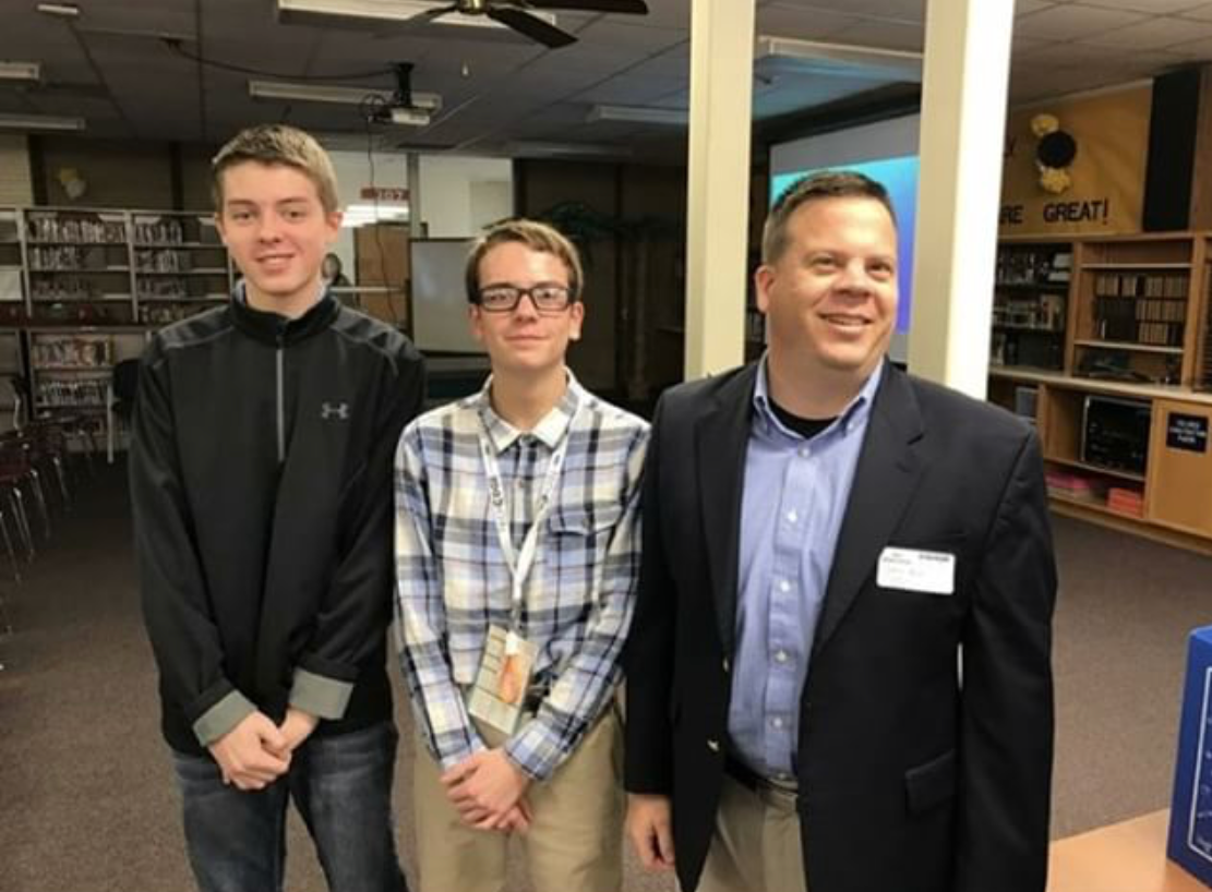 Riat Inc. members Weston Hoskins, Caden Riat, and Steve Riat at a presentation for their company.