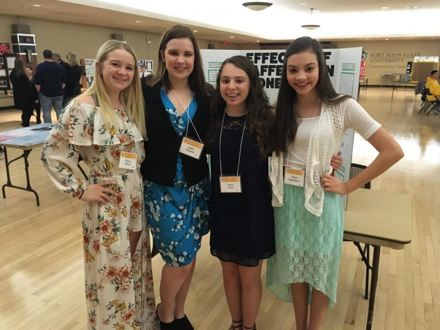 Freshmen Camry Young, Callie Raacke, Anna Brull, and Alicia Feyerherm pose for a picture before the science fair. Freshmen Audrey Rymer and Emily Kreutzer also competed.