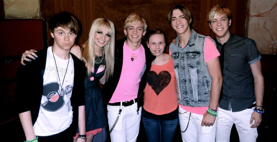 Junior Zoe C. Martin poses with the members of R5 at a concert. Martin attended the R5 concert when she was 11 years old.