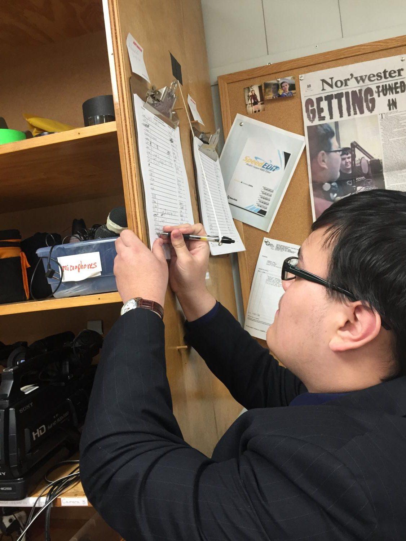 Junior Isaiah Schindler checks out a camera.