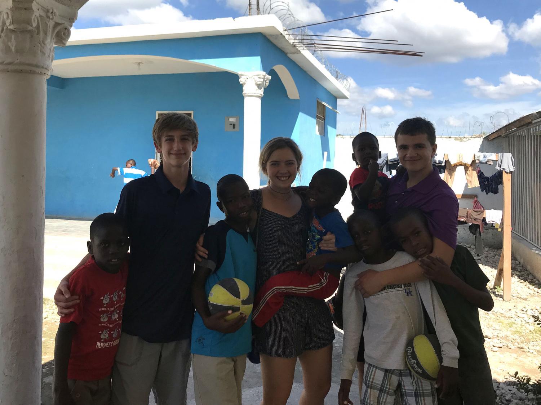 Freshman Kelby Rice, junior Josh Norris, and senior Karee Dinkel all traveled to Haiti to visit the orphans.