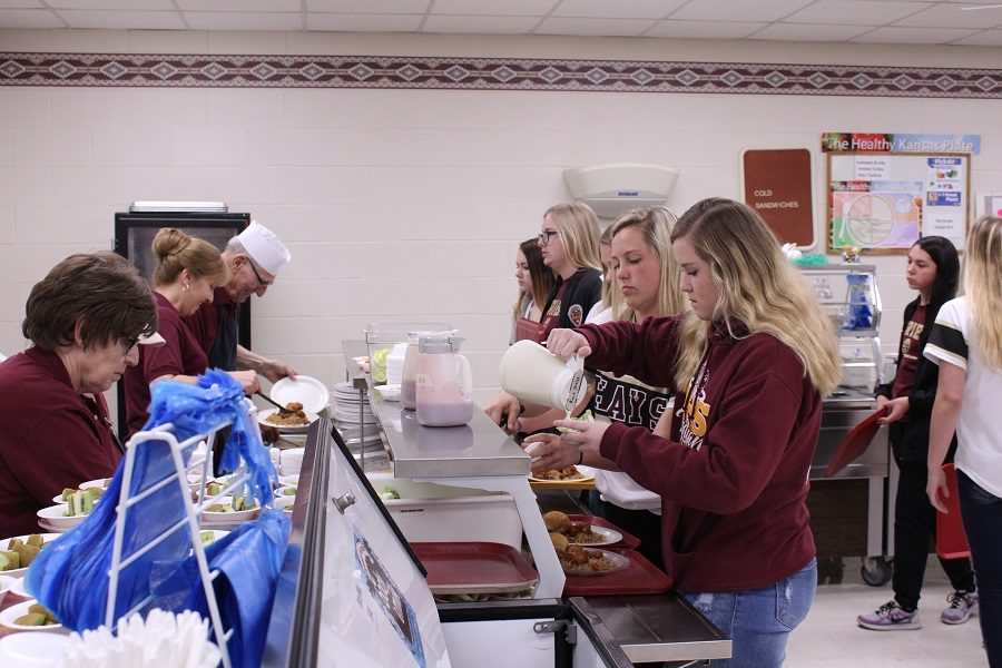 Students make selections on their way through the lunch line. With potential new rule enforcement, all students will be allowed only 20 minutes for lunch.