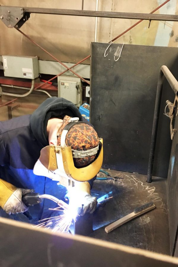 Junior+Matthew+Fross+works+on+the+welding+portion+of++the+competition.++