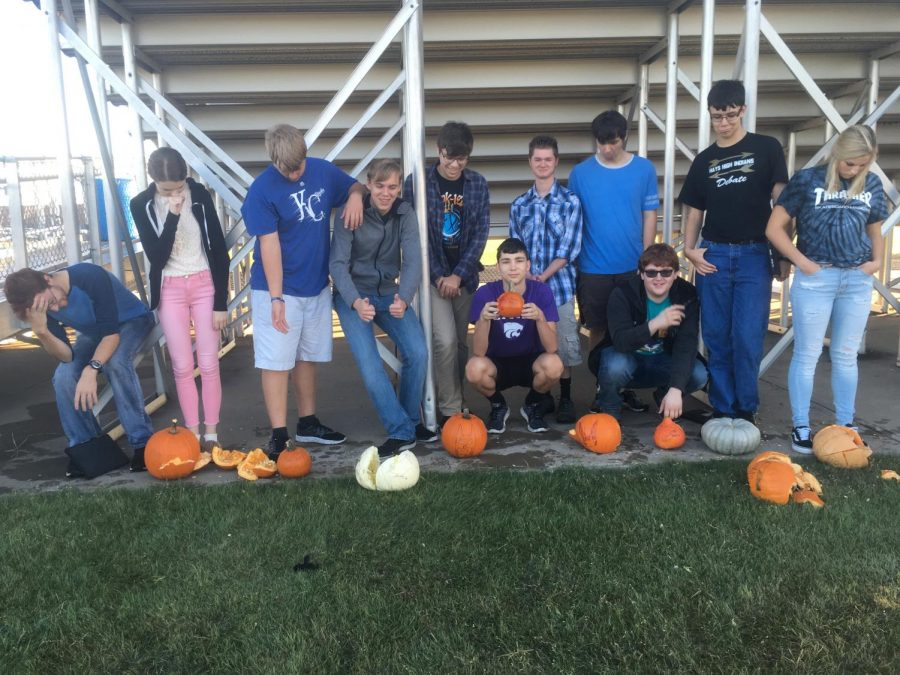 Physics+students+pose+with+their+pumpkins+after+testing+their+acceleration+due+to+gravity.+