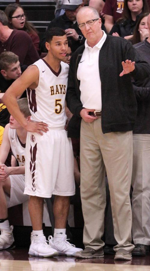 WAC Player of the Year Ethan Nunnery and WAC Coach of the year Rick Keltner discuss a prior play in a recent home game against Salina Central.