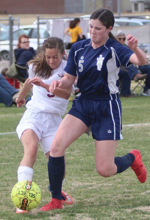 Freshman Allison Shubert fights for the ball against a TMP defender. In a 2-0 victory in recent home game on April 26.