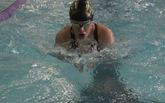 Swim team places fourth in Manhattan April 16